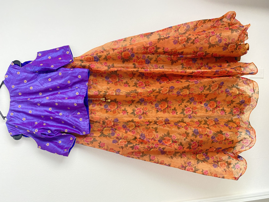 Picture of Floral digital printed organza purple and orange colour lehenga.