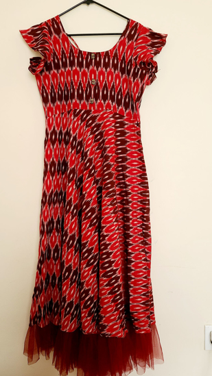 Picture of Red ikkath long frock with ruffle sleeves and net ruffles bottom of the frock