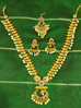 Picture of Small Lakshmi coin necklace with Tikka