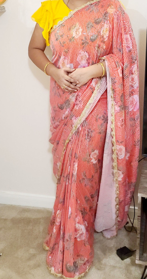Picture of Red floral sequence saree with attached designer border with ruffle sleeves blouse