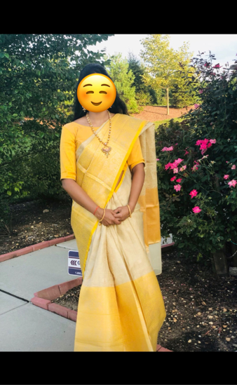 Picture of Cream and yellow saree
