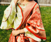 Picture of Green Dress with Red Dupatta with patterned Sleeves