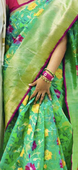 Picture of Beautiful sea green organza sari with pink blouse