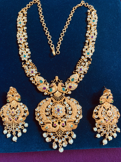 Picture of Gold finish peacock  necklace  set with ear rings